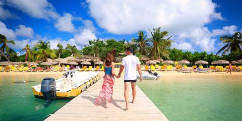 Couple walking on dock in St. Martin