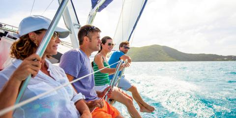 Four people on sailing yacht