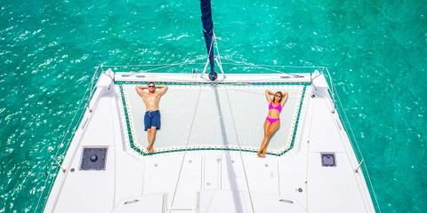 Couple on Moorings 5000 trampoline