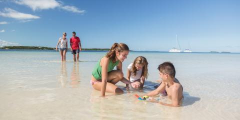 Family on beach in Bahamas