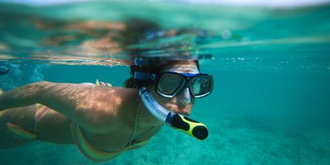 Woman scuba diving in Belize