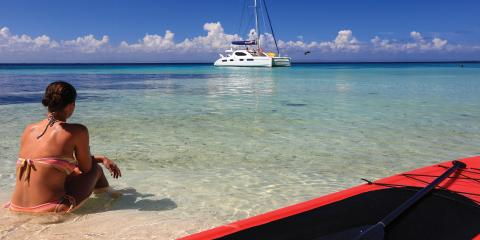 Woman sitting on beach in Belize