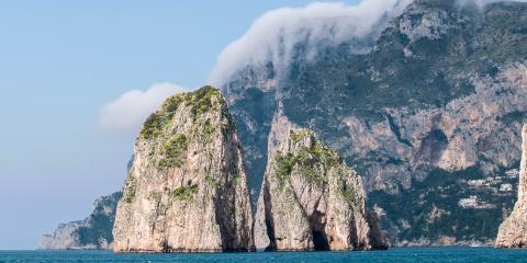 Procida stone boulders in sea