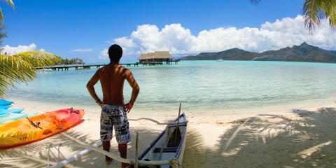 Man and canoe in Tahiti