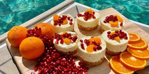 Mini cheesecakes with pomegranate and orange on board a Moorings 4500