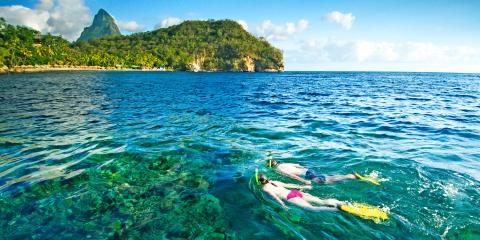 Couple snorkelling in Bluegreen waters of St Lucia