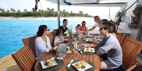 Family enjoying lunch on Moorings yacht