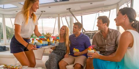 Crew with couples sailing Moorings yacht