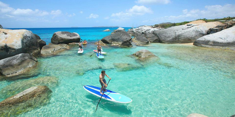 Friends enjoying stand up paddle boarding in the BVI